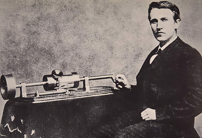 Thomas A. Edison sitting by his invention, the Phonograph, 1878  by American Photographer