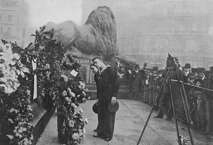 Under Nelsons Shadow: Bluejackets Inspecting Wreaths at the Foot of the Admirals Statue, published in The Graphic October 27th 1906  by English Photographer