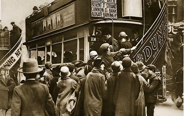 Londoners rushing for a bus on Ludgate Hill (sepia photo) by English Photographer