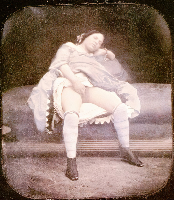 A woman resting on a chaise-longue wearing a dress, shoes and stockings, 1850 (hand-coloured stereoscopic daguerreotype) by French Photographer