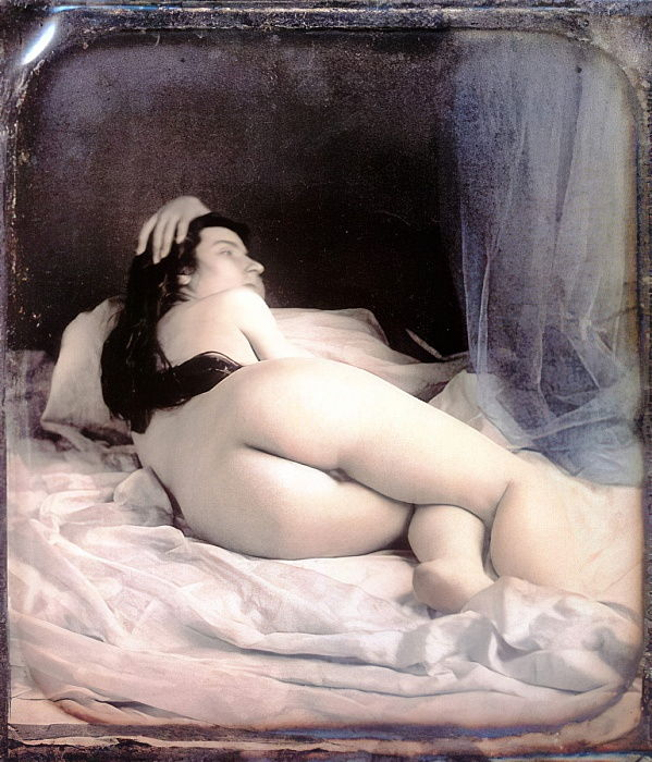 A nude woman lying on her bed showing her back, 1850 (hand-coloured stereoscopic daguerreotype) by French School