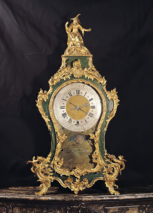 Louis XV Style clock surmounted by a chinese man (ormolu) by French School