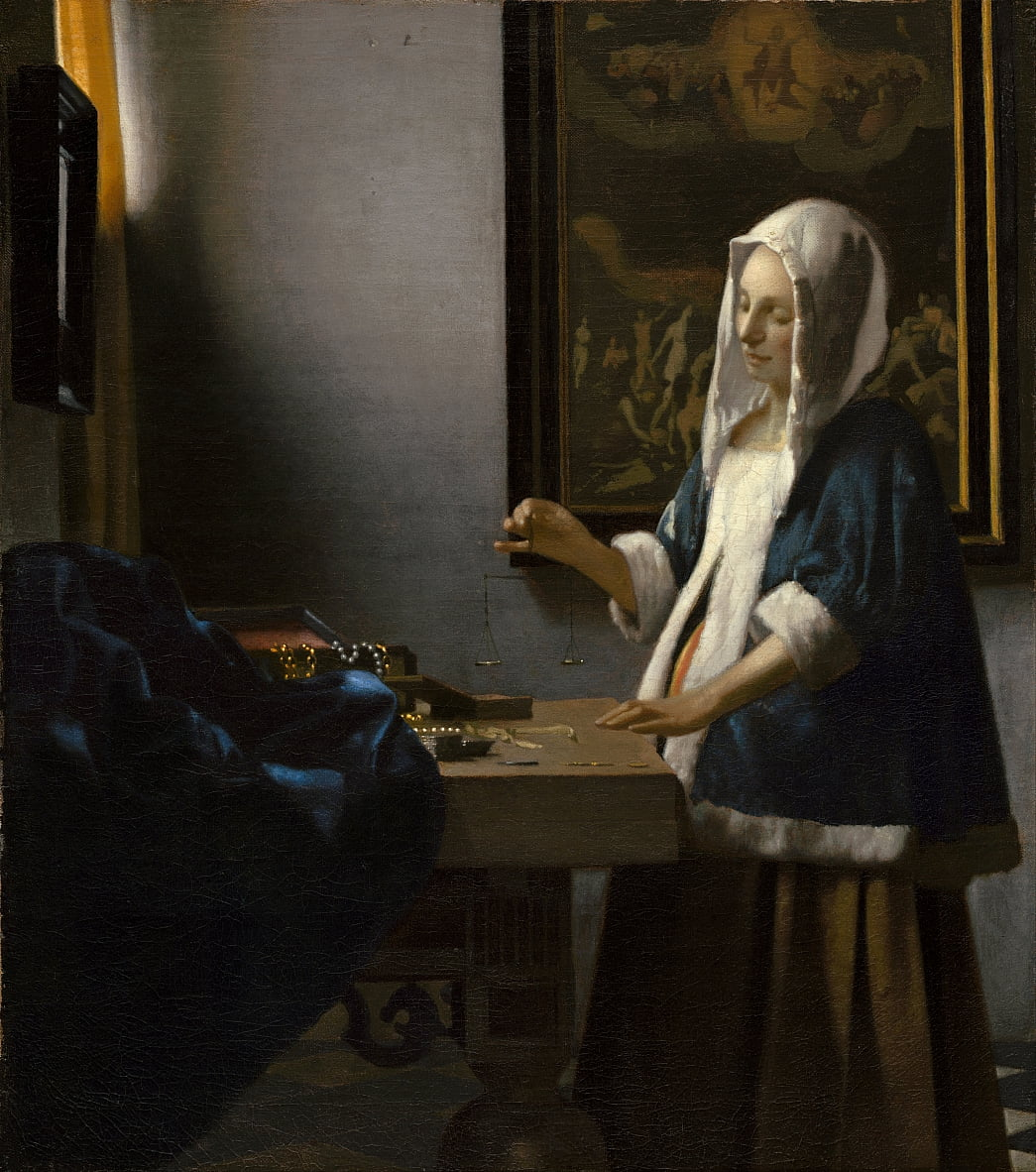 Woman Holding a Balance by Jan Vermeer van Delft