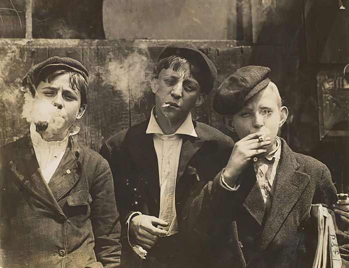 Three Young Newsboys Smoking, Saint Louis, Missouri, USA, 1910  by Lewis Wickes Hine